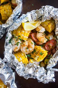 These low country boil foil packets are a breeze to make. Potatoes, corn, andouille sausage and shrimp all together in an easy foil packet!