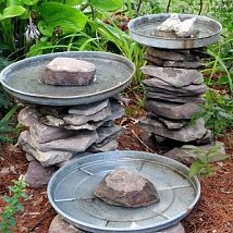 Stacked Stone Bird Baths (Garden of Len & Barb Rosen) old tin lids from trash can  love this