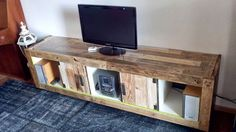 IKEA TV Stand Designs You Can Build Yourself the Expedit bookshelf has one of the most versatile designs you can find. This particular one was hacked with wooden pallets and turned into a simple-looking, somewhat rustic TV stand out outfitted with LED lights.{found on ikeahackers}.