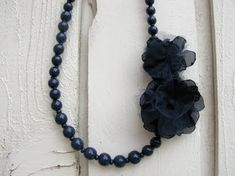 Up-cycled necklace with cute tulle flowers tutorial #upcycle #necklace