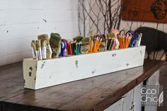 Borrowed from yesterday and repurposed for today, this 12-hole Sugar Mold Pen Holder looks just like the ones used to form small cakes of sugar in days gone by. Fill it with pens on your desk, crayons