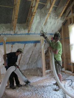 Spider Fiberglass Imsulation - As fiberglass is sprayed into the wall or ceiling cavity through a 4-inch hose, excess is vacuumed up and returned to the truck through a 6-inch hose.