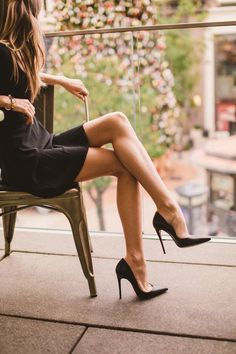 greatlegsandhighheels:  Sexy crossed legs in a little black dress and sky high Louboutins