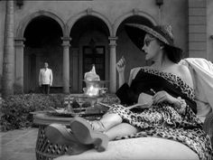 Gloria Swanson in Sunset Blvd. - look at that leopard tripm & those shoes! - Hmmmm, do styles seem to come back over years???