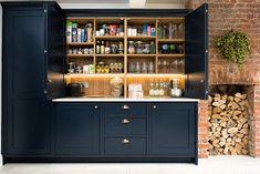 Dark blue shaker kitchen painted in Little Greene Basalt