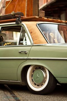 72 Mercedes W114 old skool custom.  Check out that wood-look roof and vintage roof rack!
