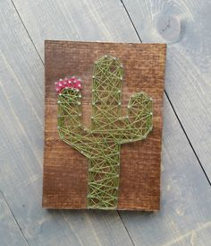 Measurements: 8.5x11.25 Background: dark walnut stain String Color: green and pink Display: comes ready to hang with a sawtooth picture