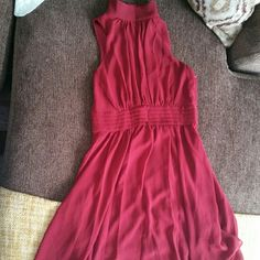 High neck dress Knee length high neck dress in burgandy. The first picture is closer to the actual color of the dress. Button detail down the back of the collar. Cummerbund detail at the waist. Fully lined. 100% Polyester. Hidden zipper up the side. Size small. Ya Los Angeles Dresses