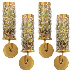 4 Italian Cylinder Sconces In Brass | From a unique collection of antique and modern wall lights and sconces at http://www.1stdibs.com/furniture/lighting/sconces-wall-lights/