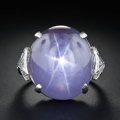 Fabulous lavender grey blue 26 carat star sapphire in an Art Deco platinum ring.