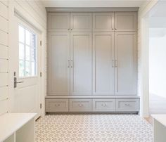 I LOVE this mud room idea: everything is hidden behind closed doors, everyone gets their own closet/drawers/cabinet. It needs a bench!!