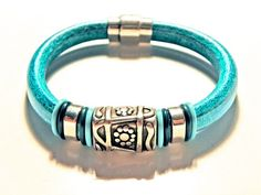 This unique original bracelet is made with authentic distressed turquoise Regaliz leather and centered in the middle is a gorgeous antique silver flower slider bead On each side there are Braided Bracelets, Handmade Bracelets, Stone Jewelry, Beaded Jewelry, Men's Jewelry, Bullet Jewelry, Bracelet Making, Bracelet Set, Maxi Collar
