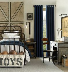 BR with Black Steel bunkbeds. Navy fabric, striped bedding, warm gray floor, with touches of dark wood. Use old trunk as a toy chest.