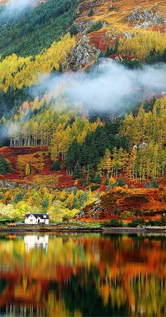Gorgeous autumn colors in the Highlands. Oh what I would give to live in that house! Click through to see 28 mind blowing photos of Scotland. @darleytravel.com