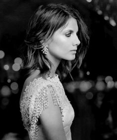 He smiled widely as he saw her come down from her apartment building. The way her dress flowed in the wind made her look like a goddess. He knew she would look lovely in white.