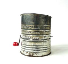 Vintage Bromwell's measuring sifter. Five cup sifter with hand crank....much easier on the hands that the squeeze handle type. Made by the Jacob Bromwell Company which is the oldest kitchen manufacturer in the United States...I still have one...