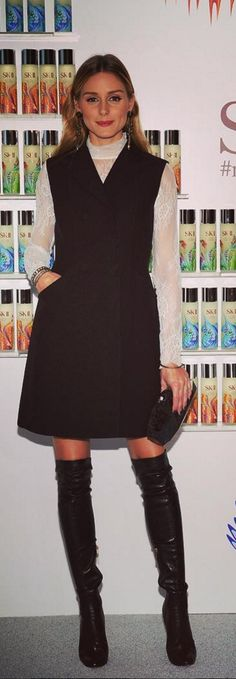 Who made Olivia Palermo's black dress, white lace long sleeve top, clutch handbag, and thigh high boots?