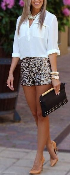 White blouse with sparkle short skirt and black stylish plan leather clutch and high heels ladies pumps and white stylish necklace