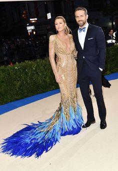 Mr. & Mrs. Brady = LOOOOVE the feathers for the bottom hem & train!