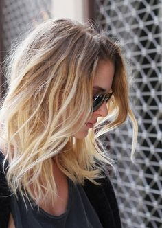 Wavy shoulder length hair with layers.