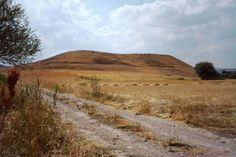 PAUL'S JOURNEY - Lystra, Turkey - The mount of Lystra, yet to be excavated. In ancient times, cities were traditionally built atop a hill for defensive reasons. In addition, as cities suffered disaster, there was no way to remove all the demolition rubble. People would rebuild right on top of the ruins.