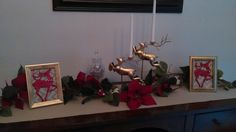 Here's another pic. I put them in my dining room with my reindeer candle holders I found at Goodwill and painted. Added a garland I already had and voila!