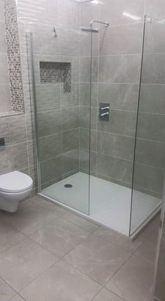 Roofingandbuilding.ie Grey shower / bathroom, double length tray with full glass doors and rainfall shower head with inserted shelves