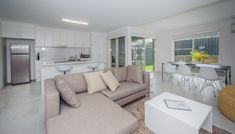 Executive Townhouses | Family Friendly Accommodation - Escape At Nobby's Washing Machine In Kitchen, Electric Bbq, Living Area, Living Room, Holiday Accommodation, Two Bedroom, Queen Beds, Townhouse, Catering