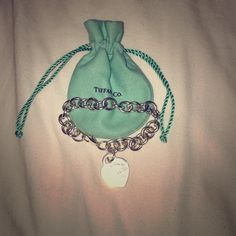 Tiffany & Co. Charm Bracelet Authentic tiffanys charm bracelet. Great condition. Had for only 4 months at the most. Comes with everything you see. Tiffany & Co. Jewelry Bracelets