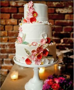 red and pink flowers wedding cake