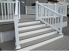 Deck made to look porch like, grey floor and painted risers on angled stairs ...