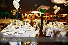 This is what white and ivory looks like.  I think I'd like colored tablecloths.   Google Image Result for http://www.lifeonprints.com/images/venues/jollyinn.jpg