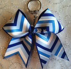 I should totally make one of these to put on my cheer bag!!
