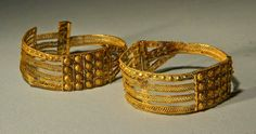 Etruscan Gold Filigree Earrings (circa 1st quarter of the 7th century B.C.) - Openwork ribbons filled with wire bands, bosses, scrolls. Probably from Vetulonia.