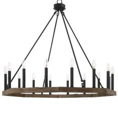Shop for The Gray Barn Orchard House Vintage Wagon Wheel Chandelier - Get free delivery On EVERYTHING* Overstock - Your Online Ceiling Lighting Store! Vintage Chandelier, Chandelier Lighting, Chandeliers, Outdoor Chandelier, Black Chandelier, Rustic Lighting, Lighting Ideas, Wagon Wheel Chandelier, Black Candles