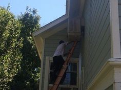 One of All Weather Heating & Air Conditioning's NATE Certified technicians reaches a difficult spot to service an HVAC unit.