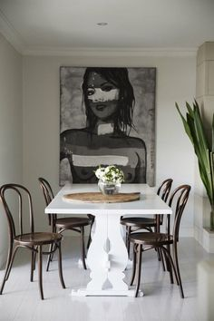 """Sneak Peek: A Sophisticated Australian Home. """"The dinning room has a David Bromley art piece that commands a certain presence within the room. The dinning table was an auction house find that cost $75. It has recently been painted and taken on a whole new look. The chairs are from Thonet Australia and surprisingly comfortable and sturdy."""" #sneakpeek"""