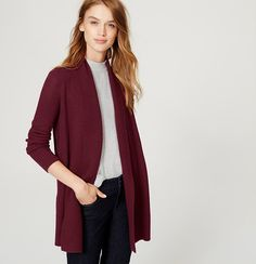 In a touchably textured knit, this totally versatile piece pulls it all together. Shawl collar. Long sleeves. Open front. Ribbed placket, cuffs and hem.