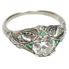 It has emerald which is my birthstone & bull horns like the Taurus, my zodiac sign.  :]