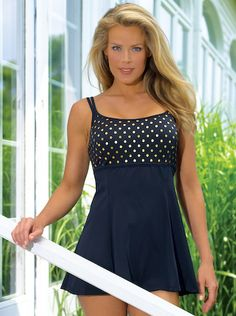 Feel absolutely fabulous in your island vacation while wearing a robby dots princess seam swimdress by Longitude . A classic swimdress with a timeless polka-dot print, bandeau neckline, and empire waste, elegantly draws attention away from the hips and thighs, while minimizing the tummy area. Its long torso design is perfectly constructed for those with longer torso measurements. This stylish Suit comes with dependable comfort and support with its soft molded bra cup and powernet tummy…