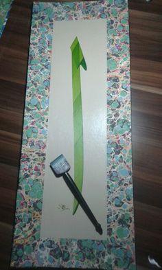 Elif harfi..Hat Sanatı : Arkın Ongan Ebru sanatı : Suna Ongan