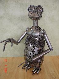 ET the extraterrestrial Metal Sculpture from the Movie ET made out of old car parts and scrap metal.