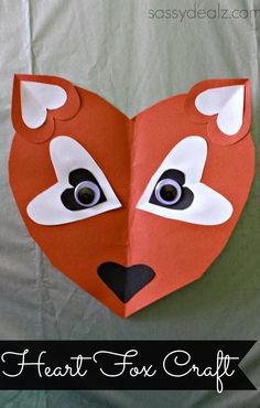Hearts of different sizes make a fox's face!