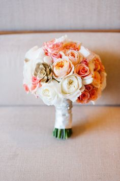 Peach, white and coral peonies with gilded succulents