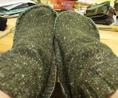 This website shows you how to make slippers out of thrift sweaters...I might try that.