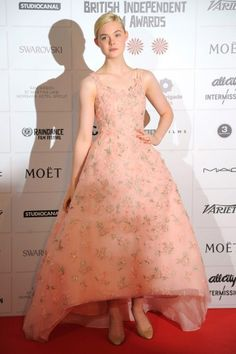 This is the current version of Gwyneth Paltrow's pink Ralph Lauren. Elle Fanning's Oscar de la Renta is pretty and girlish, but a little fantastical, too.