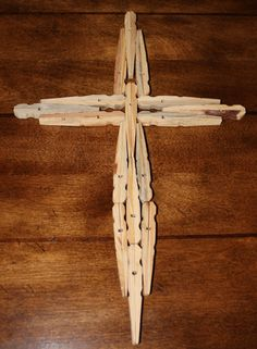 Wooden Cross made out of clothes pins. (Samantha's treasure)