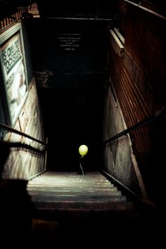let the balloon go- you can get another one! but not if you end up in another dimension without your arms!!!