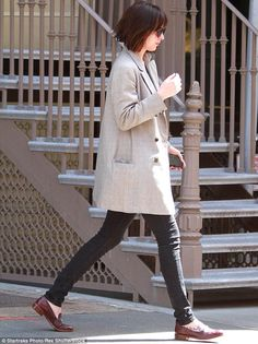 Fifty SHEARS of grey! Dakota Johnson debuts new shorter hairstyle as she steps out in NYC wearing a chic charcoal coat