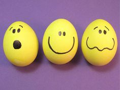 Face Eggs: A super easy way to make your eggs happy. Dye eggs yellow and let dry completely. Draw faces with black marker. Feel free to break from tradition and let your egg express other emotions. Above: 'Oh no!' 'Happy' and 'Tee-Hee.'